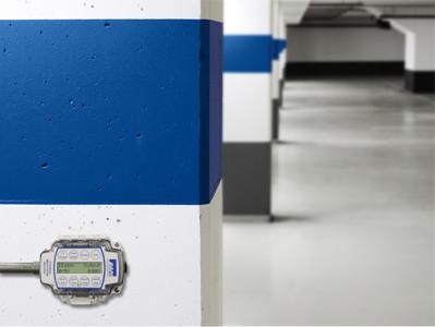 Carbon Monoxide Sensor mounted in a parking garage.