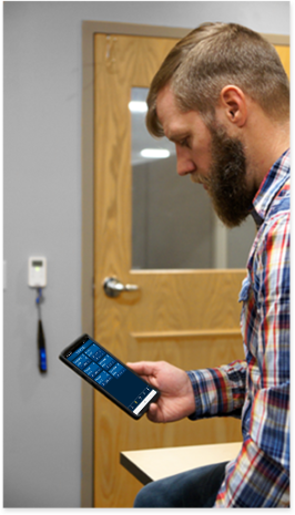 person holding phone running Blu-Test app with Blu-Test probe measuring a sensor